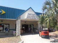 Home for sale: 1030 Palm Coast Pkwy N.W., Palm Coast, FL 32137
