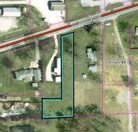 Home for sale: 0 W. Broadway St./Hwy. 50, Loogootee, IN 47553